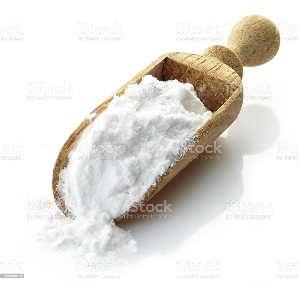 wooden scoop with potato starch stock photo