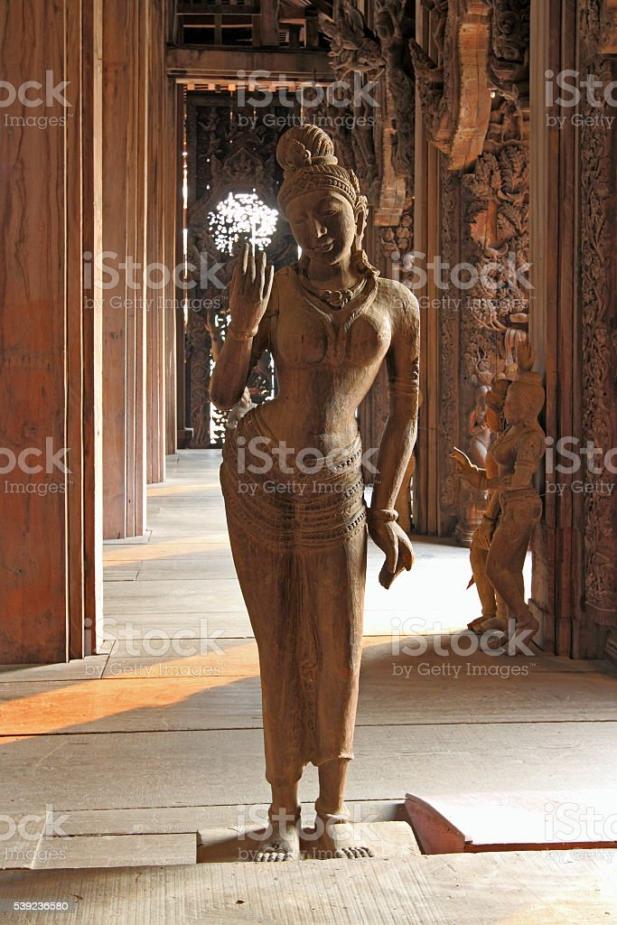 Wooden sculpture in twilight of the temple royalty-free stock photo