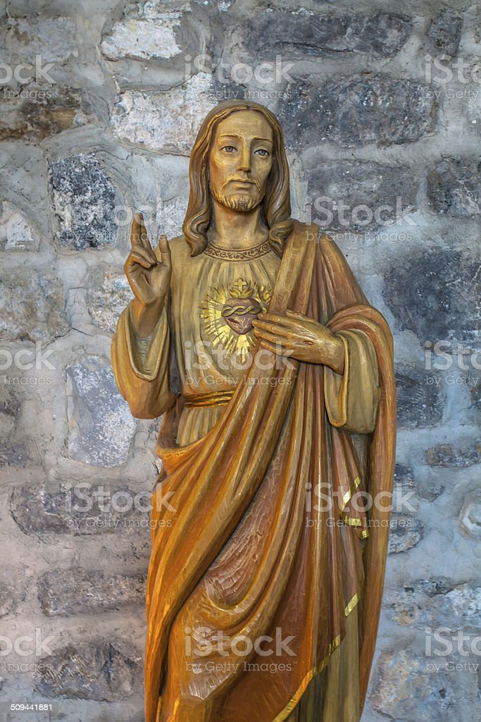 Wooden Sculpture of Jesus in a Church stock photo