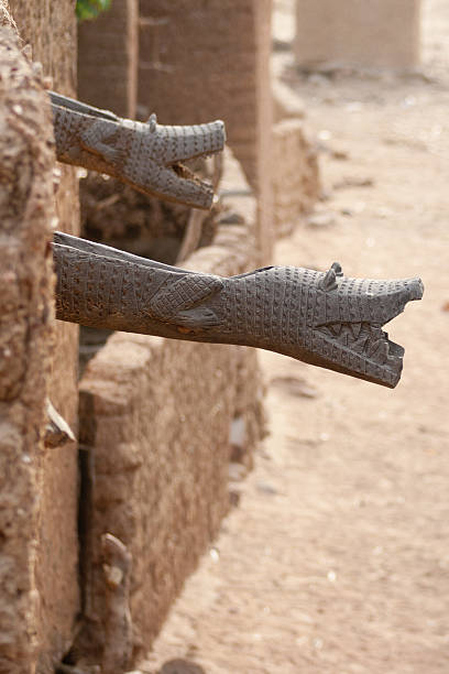 Wooden sculptures on the roof, Mali (Africa). stock photo