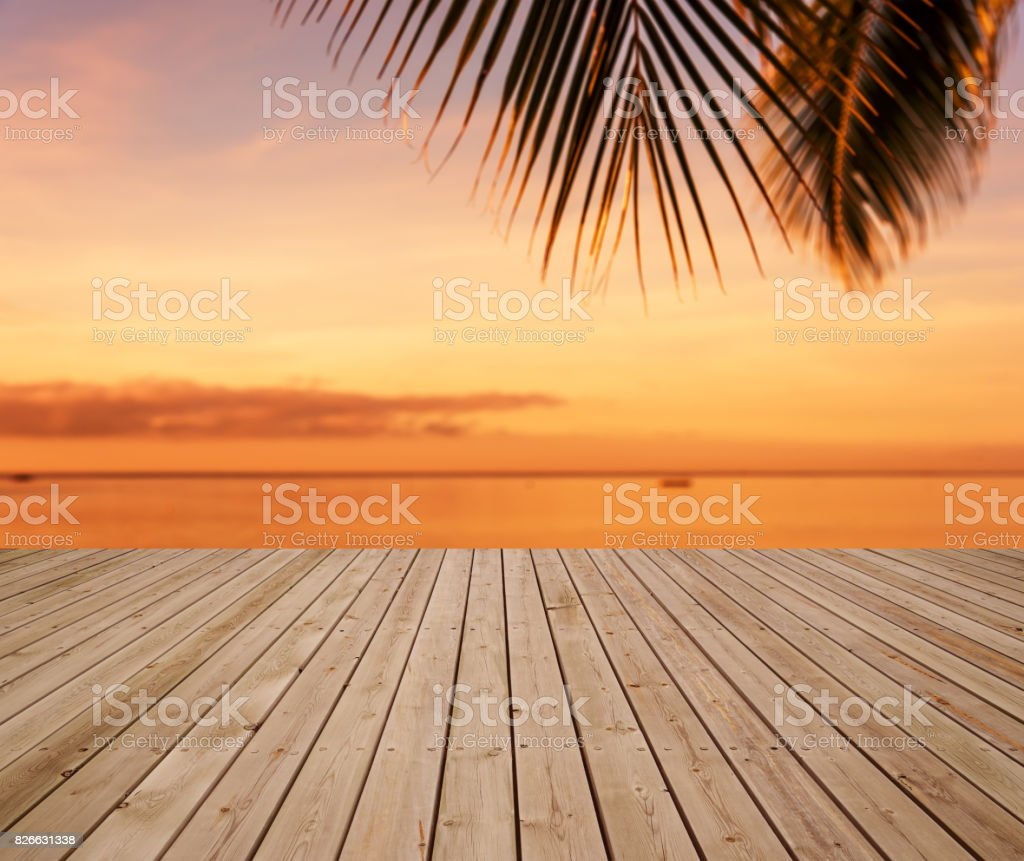Wooden sea view terrace beside tropical sea with sunset stock photo