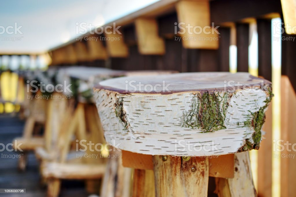 wooden seat at a bech stock photo