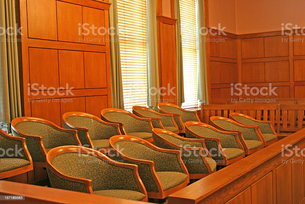 Wooden seated jury area of a clean court room royalty-free stock photo
