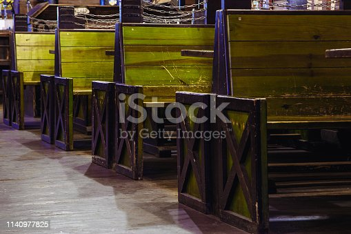 647209792 istock photo wooden seats in vintage style in a beer pub. 1140977825