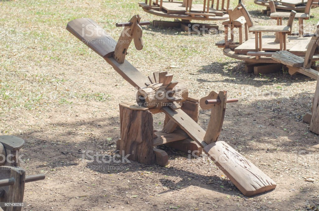 Wooden seesaw board at playground stock photo