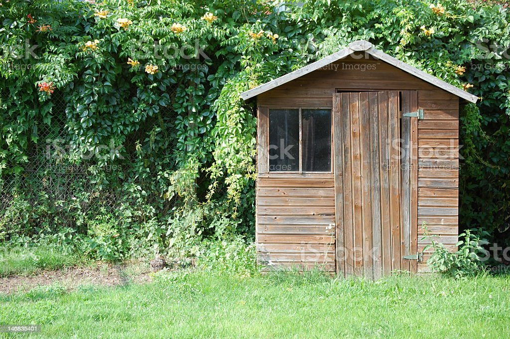 Wooden shack in someone's backyard stock photo