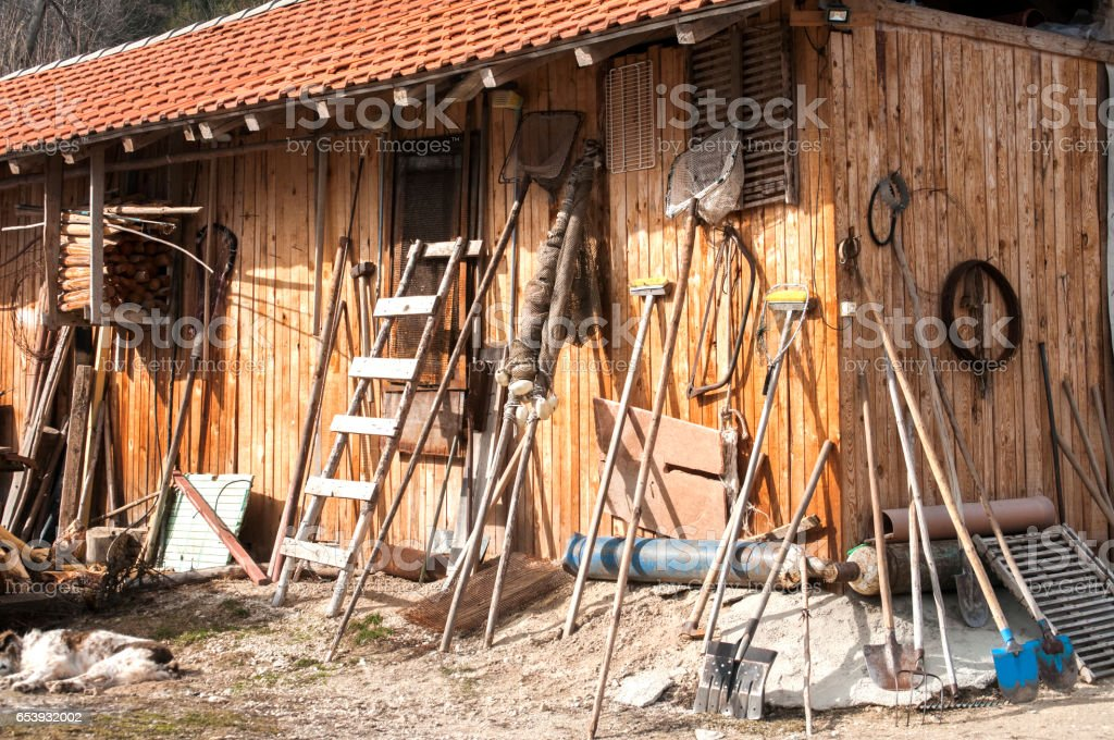 Wooden shed with tools stock photo