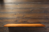 wooden shelf at wall plank background