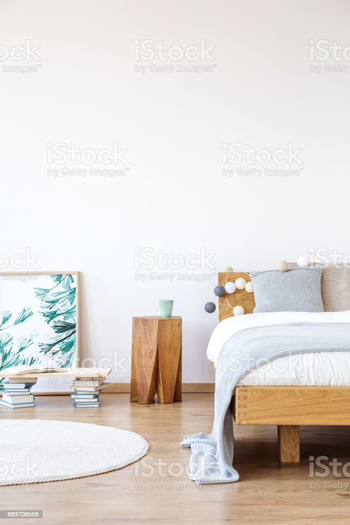 Wooden shelf supported by books stock photo