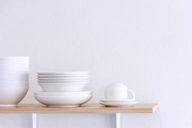 wooden shelf template isolated on white wall background which on set stacked white bowls and plates as items tableware for decorated interior or montage of your product on shelf with copy space. - naczynia stołowe zdjęcia i obrazy z banku zdjęć