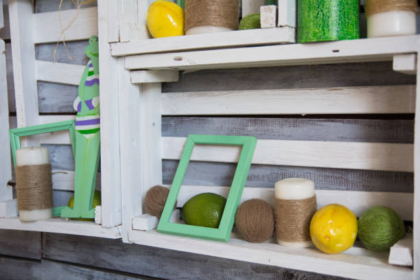 Wooden shelf with tangles of yarn and lemons stock photo