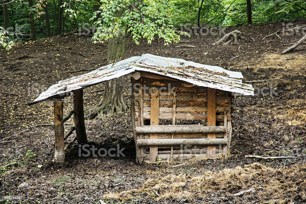 Wooden shelter for farm animals stock photo