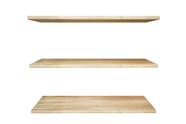 Wooden shelves isolated on white background stock photo