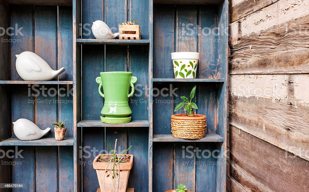 Wooden shelves of ceramic and background. stock photo