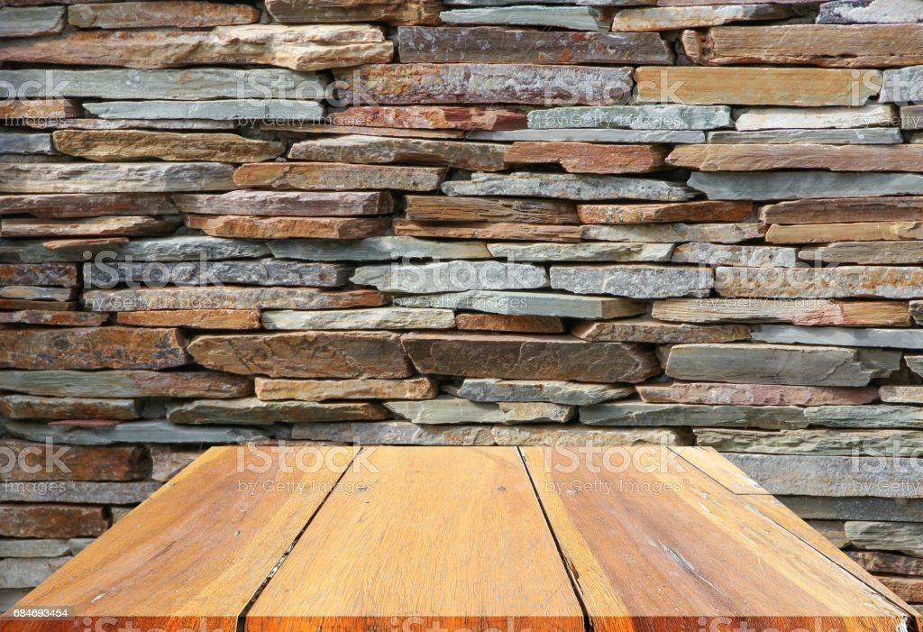 wooden shelves top empty and floor ceiling in stone wall background stock photo