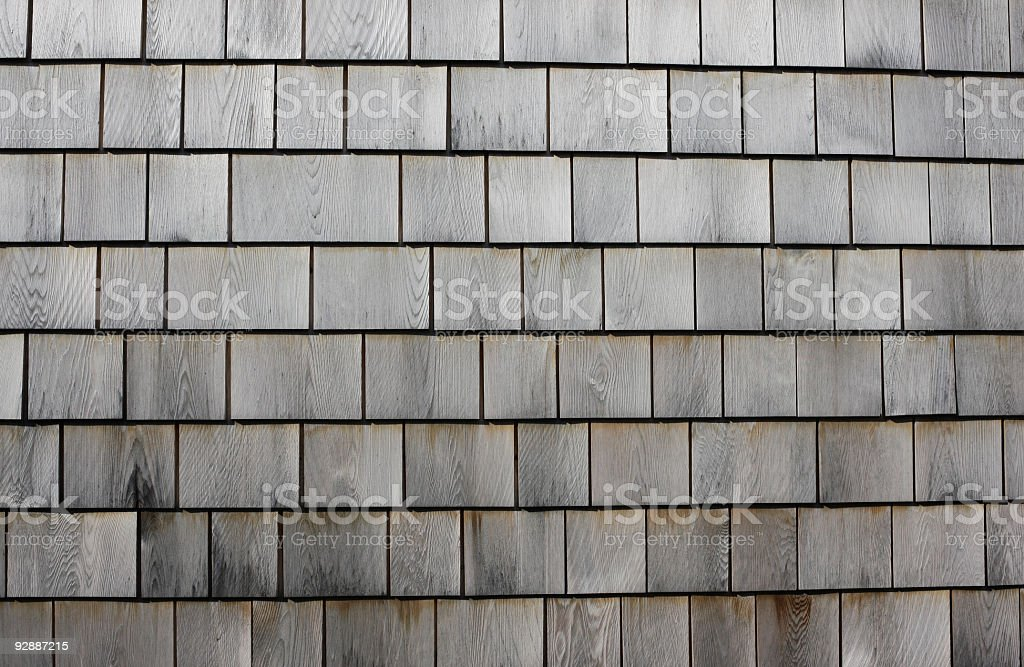 Wooden shingles in the bright sun royalty-free stock photo