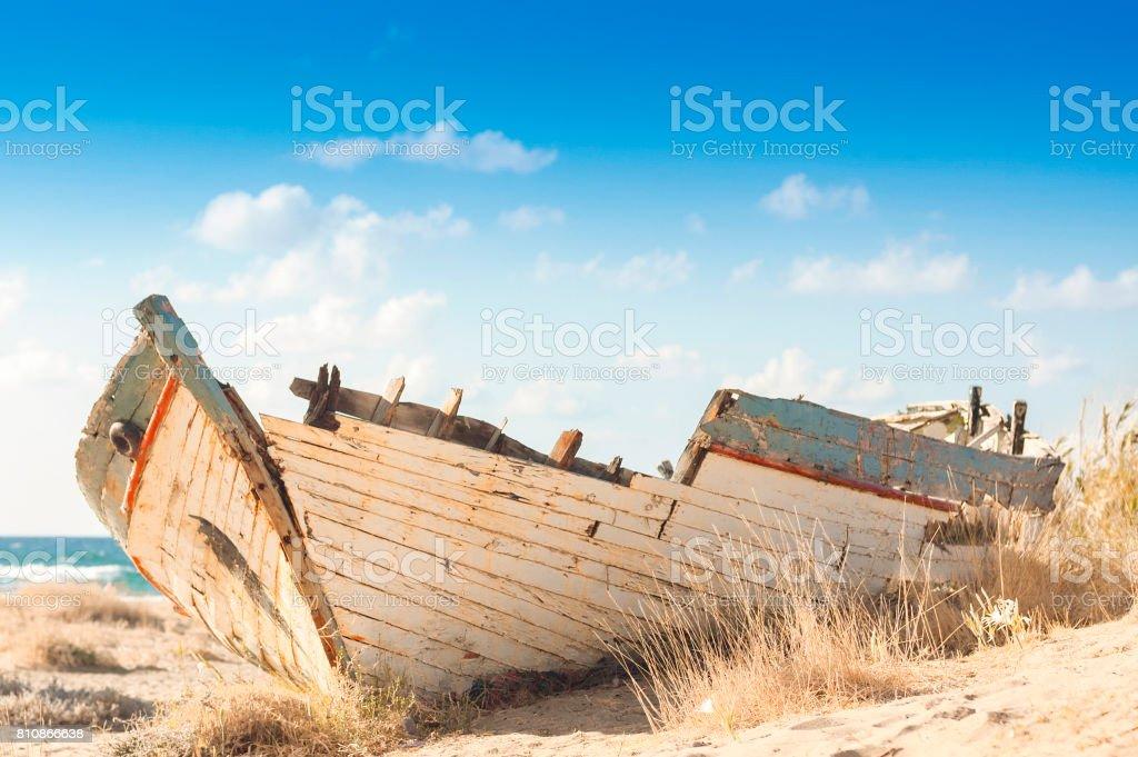 Wooden shipwreck on a beach in Malia, Crete stock photo
