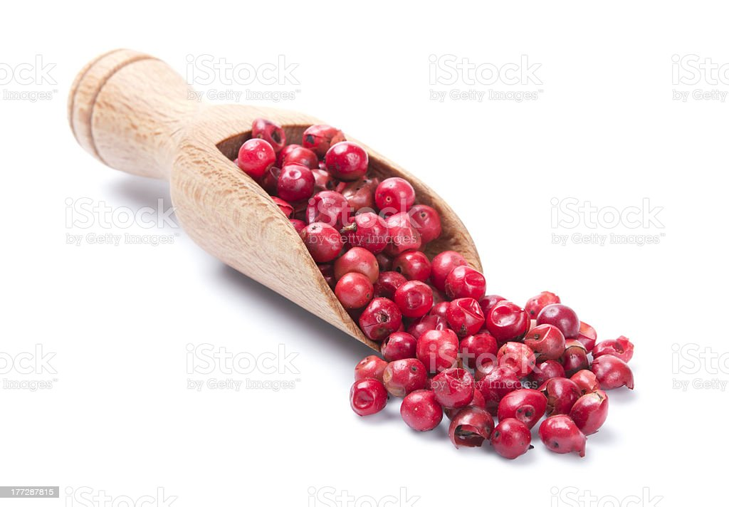 Wooden shovel with pink pepper stock photo