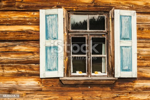 istock Wooden shutters in blue color. 483544875