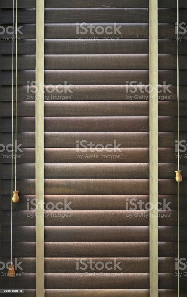 Wooden shutters on the window. Window with blinds. stock photo
