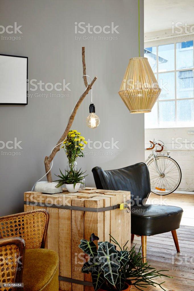 wooden side table individual design adn organic decoration in urban loft stock photo