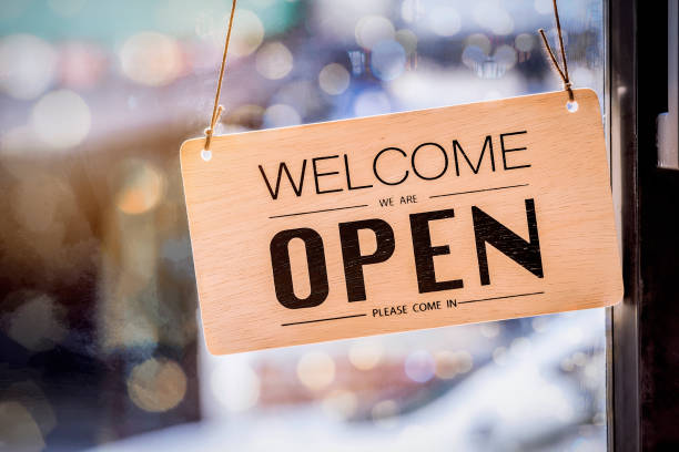 wooden sign board hanging on door of cafe - open stock photos and pictures
