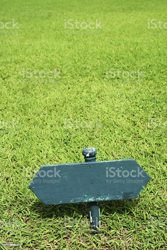 Wooden Sign on a Lawn stock photo