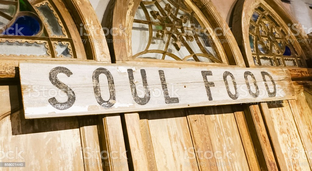 A wooden sign on ornamental doors with the words Soul Food stock photo