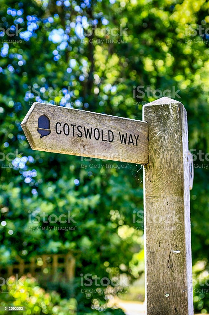 Wooden sign pointing to the Cotswold Way in the UK stock photo