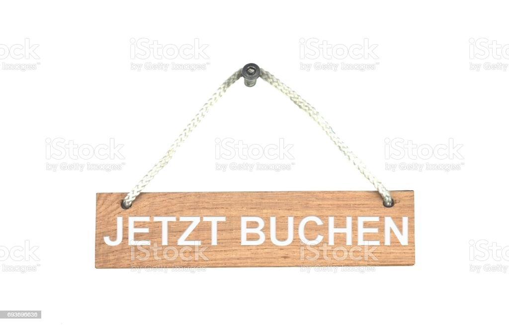 Wooden sign with rope: Book now german stock photo