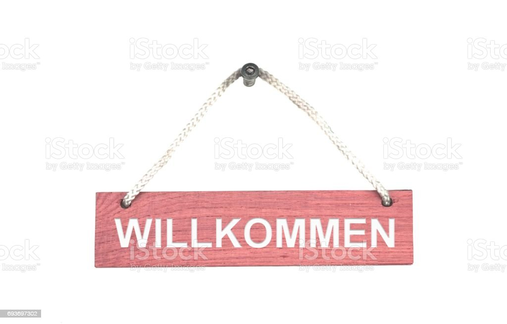 Wooden sign with rope: Welcome german stock photo