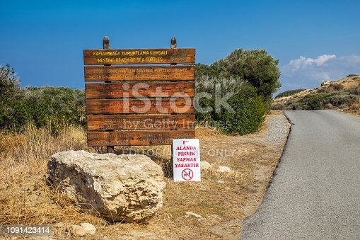 istock Wooden sign with rules of how to behave on the Alagadi turtle beach N 1091423414