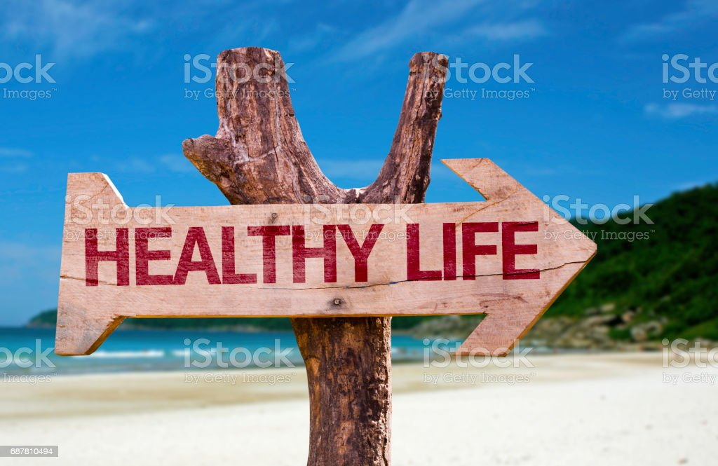 Wooden sign with the text: Healthy Life stock photo