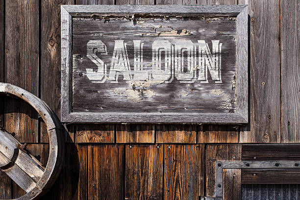wooden sign with word saloon wooden sign with word saloon, planks on the background, vintage style saloon stock pictures, royalty-free photos & images