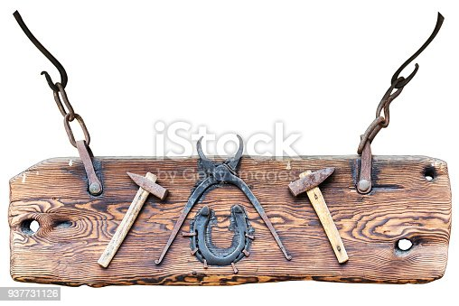 istock Wooden signboard with blacksmith tools 937731126
