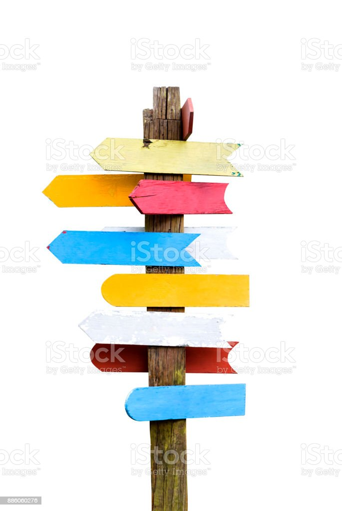 Wooden signboards pointing different directions. stock photo