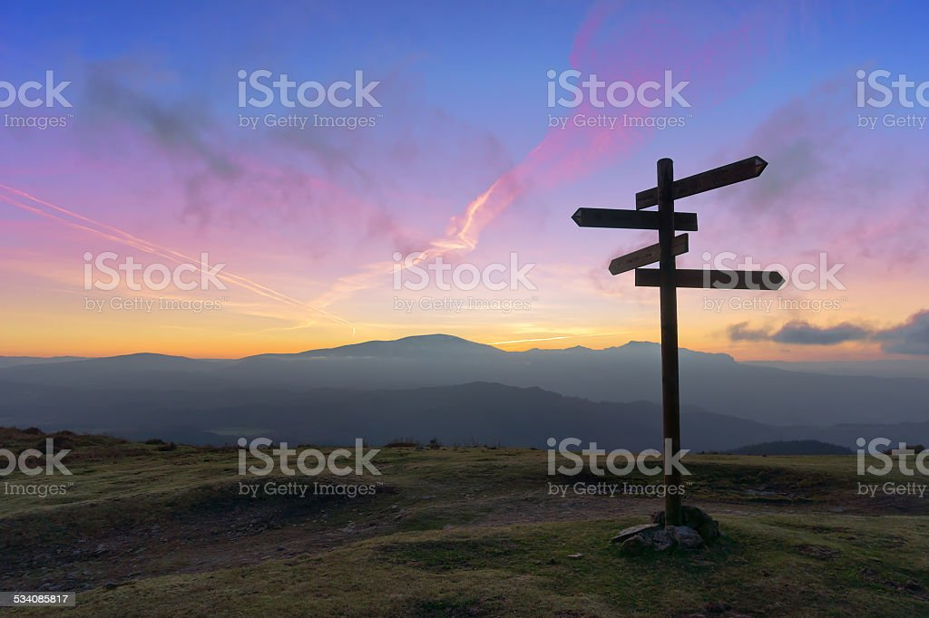 wooden signpost on mountain stock photo