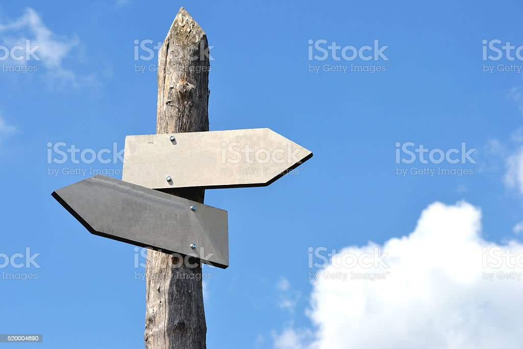 Wooden signpost with 2 arrows stock photo