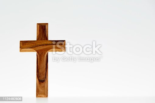 Wooden simple crucifix on white background