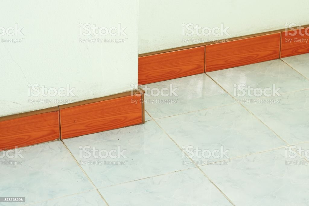 Wooden skirting boards on wall stock photo