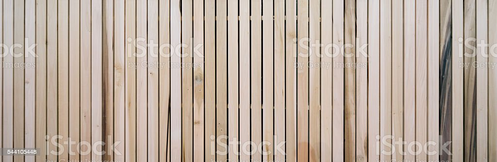 Wooden slats wall in vertical parallel pattern, background panel texture stock photo