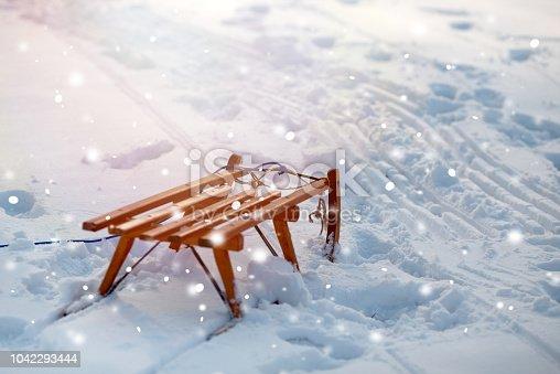 Wooden slide on snow background