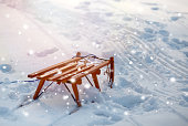 istock Wooden slide on snow background 1042293444