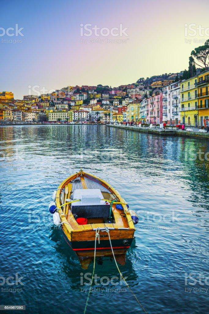 Wooden small boat  Porto Santo Stefano seafront. Argentario, Tuscany, Italy stock photo
