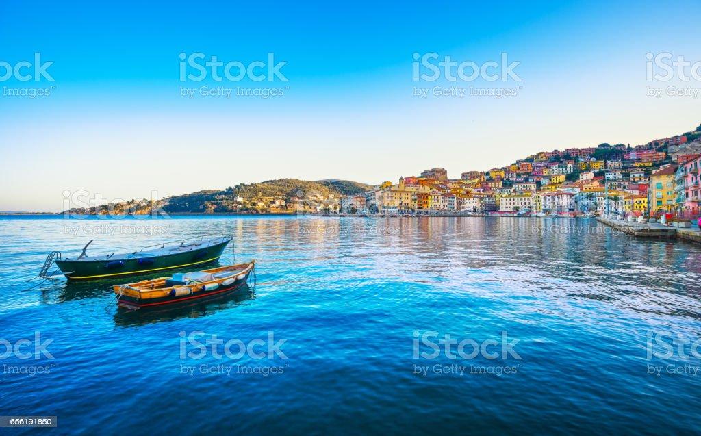 Wooden small boats in Porto Santo Stefano seafront. Argentario, Tuscany, Italy stock photo