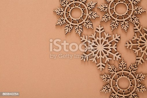 istock Wooden snowflakes pattern on beige background 865840254