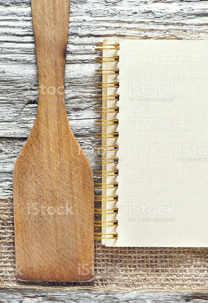 Wooden spatula, notebook and ribbon royalty-free stock photo
