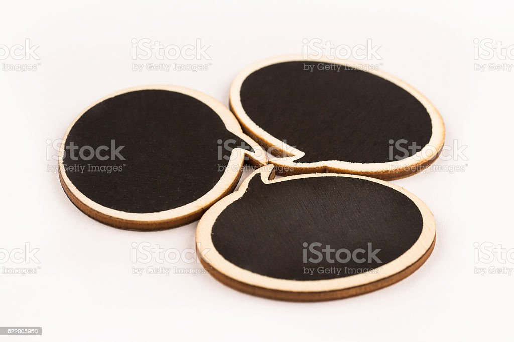 wooden speech bubbles next to each other stock photo