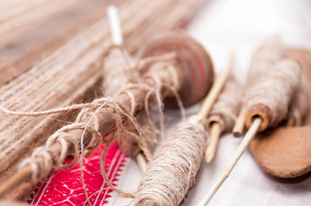 wooden spindles with hemp threads - mahroch stock pictures, royalty-free photos & images