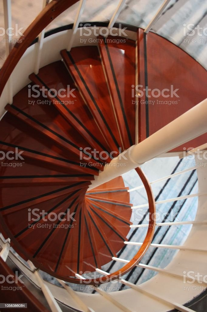Above view on a spiral wooden staircase with steps
